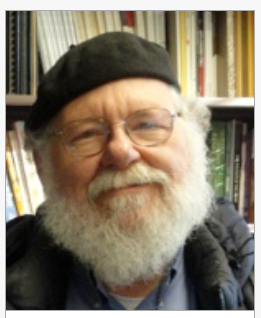 man wearing beret and glasses with white beard