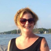 woman in sunglasses on lake