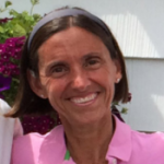 woman with short brown hair in pink shirt