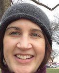 woman in winter hat outside smiling