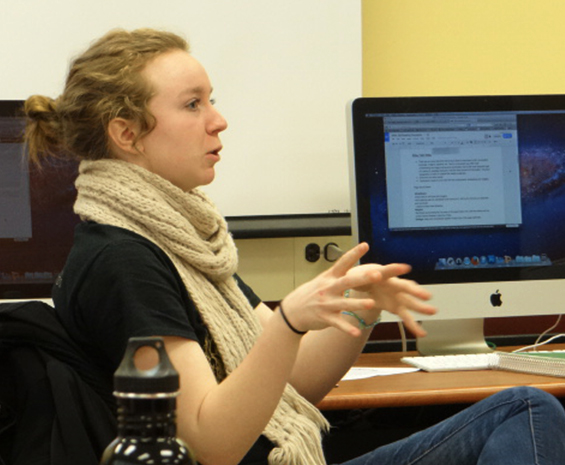 student talking near computer