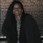 headshot of Sharieka Botex, a person of color with long black hair