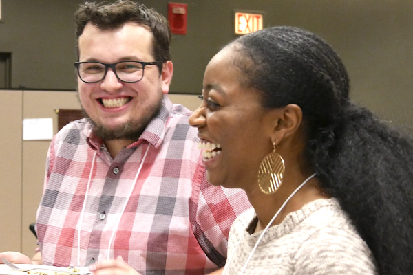 This image shows two grad students laughing together.